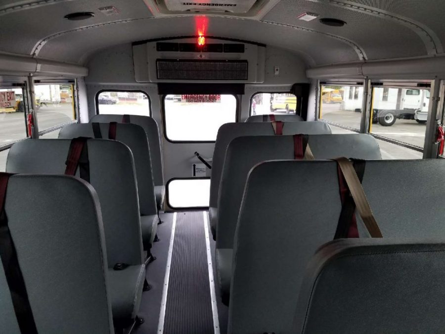 Interior of bus showing seats and the emergency exit door