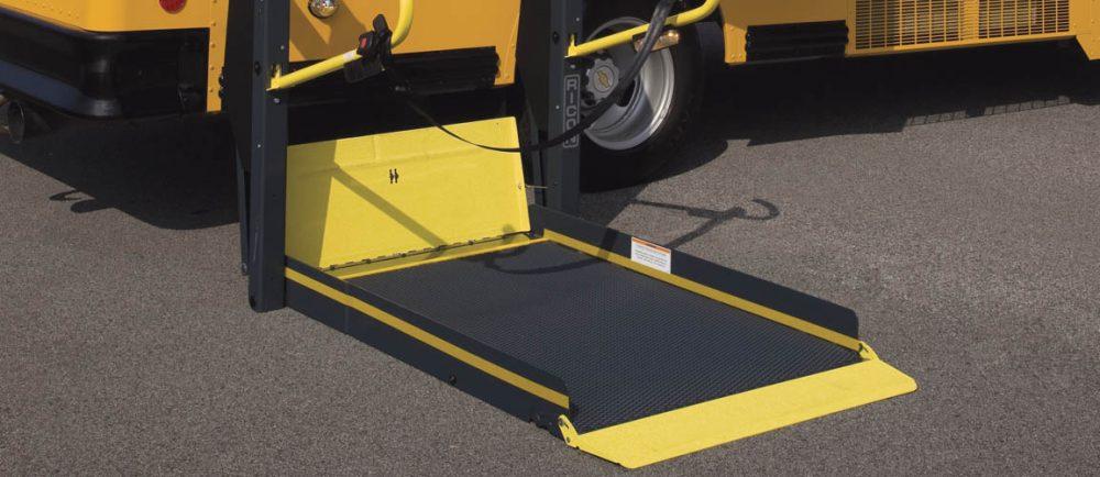Handicap ram closeup on yellow school bus